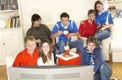 Friends Watching Football Match - stock photo