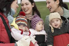 Stock Photo of Mothers With Babies In Slings At Park