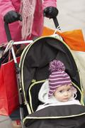 Mother Walking With Baby In Stroller - stock photo