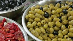 Green olives  and sun dried tomatoes in bowls Stock Footage