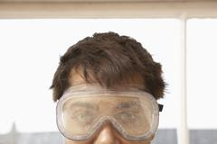 Close-Up Of Man Wearing Protective Goggles - stock photo