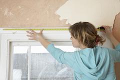Woman Measuring Window Frame With Tape Stock Photos