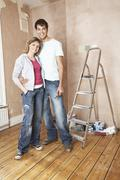 Happy Couple Standing In Unrenovated Room Stock Photos