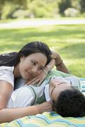 Couple Spending Leisure Time In Park Stock Photos