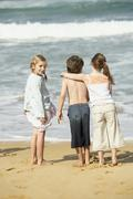 Stock Photo of Young Girl With Friends At Beach