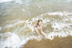 Stock Photo of Girl Playing In Water