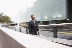 Businessman Walking Up Outdoor Ramp Stock Photos