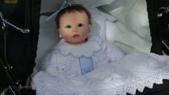 close up of vintage pram with doll - stock footage