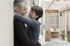 Loving Couple Embracing At Porch - stock photo