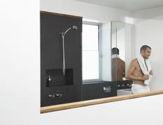 Man Leaning Against Sink In Bathroom - stock photo