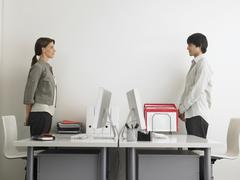 Business People Standing At Computer Desks Stock Photos