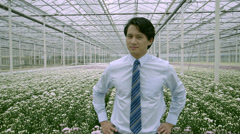 MS Portrait of businessman standing in greenhouse - stock footage