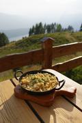 Austria, Carinthia, Nock Mountains, Millstaetter Alpe, cheese noodles at chalet Stock Photos