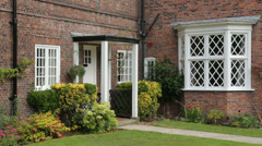 Porch and front garden of arts and crafts house, england Stock Footage