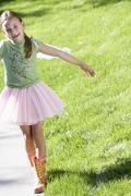 Cute Girl Walking On Sidewalk Stock Photos
