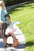 Girl In Fairy Costume Embracing Mother At Park - stock photo