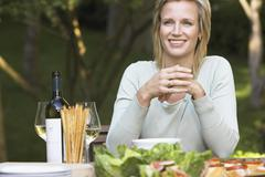 Woman Sitting At Dinning Table - stock photo