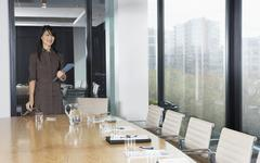 Businesswoman Standing At Table In Boardroom Stock Photos