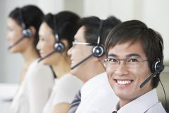 Stock Photo of Customer Service Operators Wearing Headsets