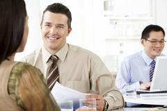 Stock Photo of Business People Discussing In Office