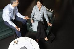 Business People Discussing At Coffee Table - stock photo