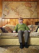 Senior Man Sitting On Sofa - stock photo