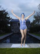 Senior Woman In Swimwear Standing By Poolside Stock Photos