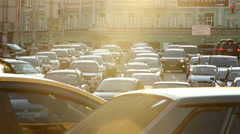 Ambulance in traffic jam city stuck street, dusk sunlight rays Stock Footage