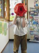 Boy Hiding His Face With Ball - stock photo