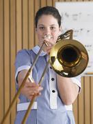 Stock Photo of Female Playing Trombone