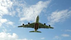plane flies low overhead to land - stock footage