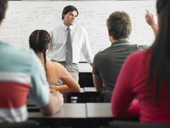 Students In Classroom With Professor - stock photo