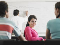 Stock Photo of Teenage Girl Attending Lecture In Classroom