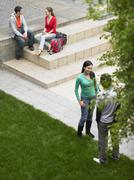 Students In University Campus Stock Photos