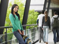 Teenage Girl Leaning Against Railing Stock Photos