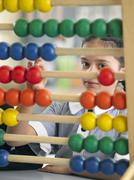 Girl Using Abacus In Classroom Stock Photos