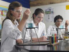 Students Caring Out Experiments In Laboratory - stock photo