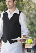 Waiter Holding Slice Of Pie At Cafe Stock Photos