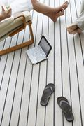 Couple With Slippers And Laptop - stock photo