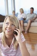 Young Woman On Call At Home Stock Photos