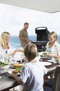 Stock Photo of Family Enjoying A Barbecue