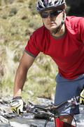 Male Cyclist In Field Stock Photos