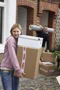 Stock Photo of Couple Moving House