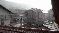Bright raining day with a view of many roof tops Stock Footage