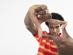Young Man Making Frame With Fingers Stock Photos