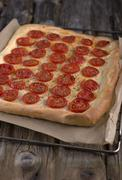 Fresh focaccia with tomatoes - stock photo
