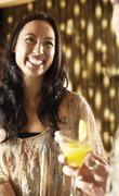 Stock Photo of Smiling Young Woman At The Bar
