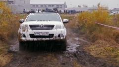 Stock Video Footage of Car moves on dirty rally road