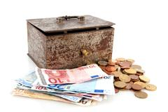 Stock Photo of old rusty money box with euros