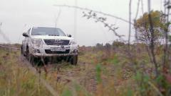 Car moves on dirty rally road Stock Footage